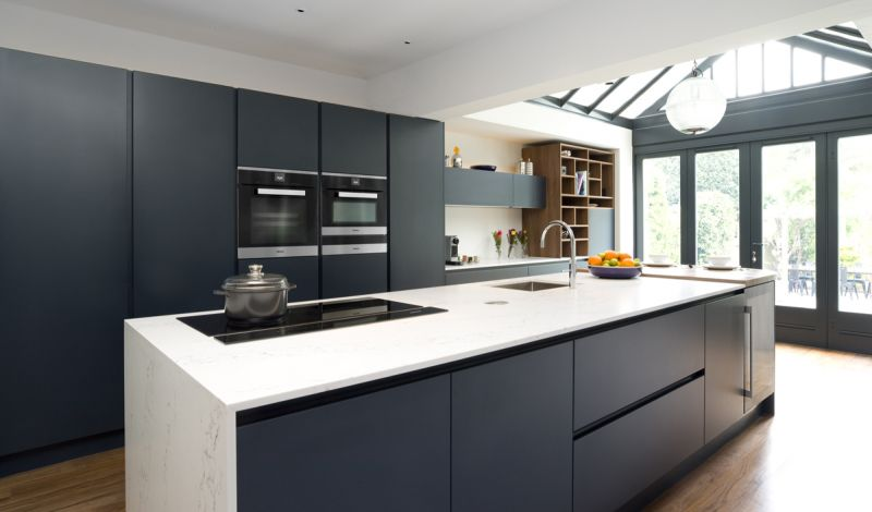 A composite solid surface allows appliances and sinks to blend seemlessly into preparation and dining areas